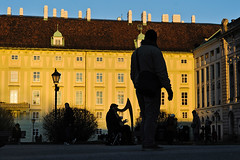 Color Photographs 05 (kirill.kuzminykh) Tags: vienna wien city sunset people music playing color building classic yellow architecture austria sterreich europa europe leute sonnenuntergang outdoor details sightseeing menschen gelb stadt architektur musik harp farbe spielen heldenplatz sehenswrdigkeit strassen baukunst ben harfe   strase drausen