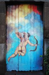 Painted Doors of Funchal (Mark Wordy) Tags: art painting naked nude island bottom bow cherub arrow oldtown madeira painteddoors funchal