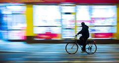 Bicolor Bicycle | Day 189 / 365 (marcin baran) Tags: street city people urban man motion blur color colour window colors lines bike bicycle silhouette shop night speed dark person one evening rainbow movement blurry colorful alone fuji ride darkness display pov candid awesome streetphotography poland polska blurred riding human fujifilm panning gliwice x100 polamd marcinbaran x100t