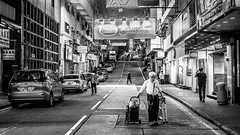 On the way back home (Calvin Lee a.k.a calvin83) Tags: road street city people urban blackandwhite bw man night walking lights crossing aged heavy signboard