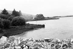 Quiet Man Bridge 02 (Ian Atrus Gazzotti  iangazzotti.com) Tags: bridge ireland blackandwhite bw water rock stone analog 35mm river nikon bn connemara biancoenero irlanda nikonf70 f70 oughterard quietman glengowla
