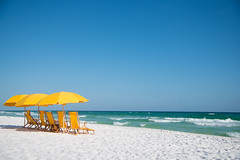 Yellow beach umbrella and chairs on white sandy beach, blue sky, Gulf of Mexico (Earl Robicheaux Photography, LLC) Tags: usa sun sunlight beach gulfofmexico sunshine weather seaside sand scenery florida unitedstatesofamerica bluesky shore land northamerica environment coastline whitesand beachtowel seashore sandybeach sandestin beachresort miramarbeach beachchair beachumbrella equipmentobjects waltoncounty worldregionscountries beachitems