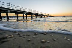 Sunset-DSC03879-120116 (Igor Vlah) Tags: sunset sea sky sun beach pier waves stones sony slovenia 12mm portoroz samyang a6000