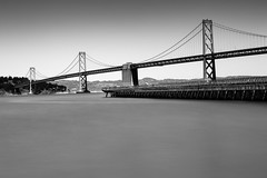The Bay Bridge (marq4porsche) Tags: ocean sf sanfrancisco city longexposure bridge light urban blackandwhite bw water architecture canon bay pier daylight highway downtown freeway baybridge manmade 50mm12 canon6d