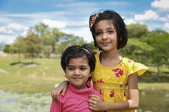 Sisters (Fazar Photography) Tags: pink girls sky lake tree smile face yellow clouds sisters garden kl metropolitan taman