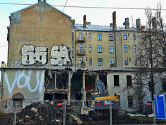 Demolition of one more ong-time unattended building in central Riga, Latvia. February 6, 2016 (Vadiroma) Tags: city graffiti ruins europe capital demolition latvia wreckage riga excavator 2016 rga latvija
