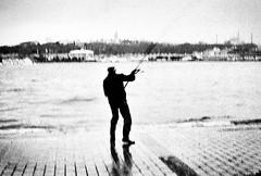 Fishing (masisus) Tags: film analog lomography streetphotography bnw contaxg2 ladygrey instagram ifttt