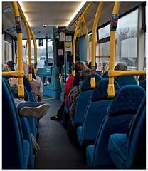The bus journey (Hugh Stanton) Tags: bus feet transport passengers seats driver handles arriva