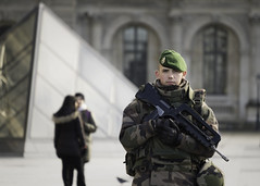 This is Paris (wacphoto) Tags: boy portrait man paris france soldier gun louvre military guard documentary police artmuseum beret parisfrance armedguard fuji55200 fujixt1 wendychapman attackinparis