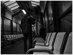 the boredom of waiting.... (bevscwelsh) Tags: night railwaystation waitingroom bidston panasonic14mm olympusem5