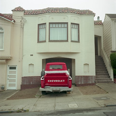 (patrickjoust) Tags: sanfrancisco california ca red usa house color 6x6 film home analog america truck us focus san francisco mechanical united north patrick row negative medium format states manual northern joust sunsetdistrict estados c41 unidos kodakportra400 autaut patrickjoust lipcarollopautomatic28