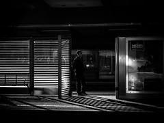 waiting (Sandy...J) Tags: street city light shadow people urban bw sunlight white man black lines station silhouette backlight germany dark deutschland photography mono licht blackwhite waiting noir fotografie darkness streetphotography atmosphere bahnhof olympus menschen stadt wait sw mann monochrom schatten atmosphre stimmung gegenlicht dunkelheit linien sonnenlicht bahnstation schwarzweis strase strasenfotografie