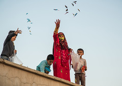 women with face masks throwing sweets to kids during a wedding, Hormozgan, Kushkenar, Iran (Eric Lafforgue) Tags: wedding people woman boys childhood horizontal kids children outdoors togetherness clothing women asia veil iran muslim islam traditional religion ceremony culture marriage persia east celebration entertainment gifts masks arab covered giving sweets iranian textiles custom adults cultures cultural islamic burqa middleeastern persiangulf fourpeople generosity donating burka chador 4people traditionalclothing hormozgan burqua إيران иран イラン irão straitofhormuz 伊朗 colourpicture 이란 borqe kushkenar irandsc06168
