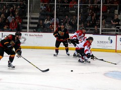These guys are so fast it's hard to keep track of the puck. (kennethkonica) Tags: people usa black color ice sports hockey america canon movement midwest flickr random indianapolis helmet culture indy indiana indoor uniforms puck persons echl global canonpowershot icerank prosports westernconference indianafairgrounds indyfuel chicagoblackhearts scotthilliman