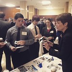 Students receiving stickers and other give aways at a career fair