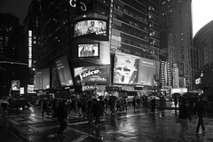The Wet Rush (Lojones13) Tags: people blackandwhite newyork rain umbrella timessquare