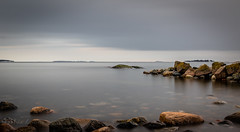 Serene (Mika Laitinen) Tags: ocean longexposure winter sky seascape nature water rock stone clouds suomi finland helsinki calm balticsea serene vuosaari uusimaa uutela ef24105mmf4lisusm canon7dmarkii