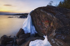 lake superior / graffiti rock (twurdemann) Tags: longexposure sunset sky snow seascape ontario canada ice nature water clouds landscape horizon shoreline scenic melt lakesuperior thaw northernontario stonebeach nikcolorefex graffitirock viveza sunlightfilter sawpitbay highway17n 06ndsoftgrad detailextractor gnd2s fujixe1 xf14mm leeseven5 cottrellcove