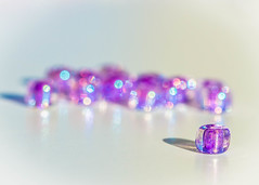 Purple (chica1956) Tags: beads shiny purple bokeh sunny sunlit irridescent
