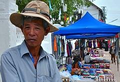 Laos-Luang Prabang (venturidonatella) Tags: portrait people men colors look nikon asia faces market hats streetlife streetscene persone sguardo laos colori ritratto gentes luangprabang volti d300 cappelli nikond300