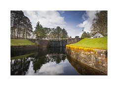Kytra lock (jonathan.bate.80) Tags: trees reflection clouds canon landscape scotland canal fort lock cottage augustus caledonian