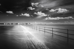 The Walk (jellyfire) Tags: sea blackandwhite seascape tourism beach water monochrome clouds zeiss sunrise canon landscape dawn mono coast countryside movement sand waves unitedkingdom tide shingle coastal shore northsea infrared essex beachhuts ze eastanglia foreshore brightlingsea landscapephotography sunrisecoast batemanstower canon5dmkii distagont3518 zeissdistagont18mmf35ze