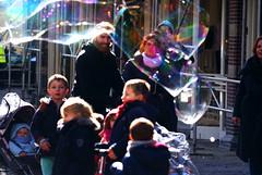 De magie van zeepbellen.  000 (George Ino) Tags: copyright holland netherlands kids backlight children parents soap utrecht kinderen nederland ouders tegenlicht zadelstraat giantsoapbubble georgeino georgeinohotmailcom naturenatuurnatur zeepbellem