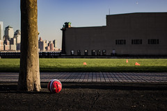 Just Waiting to be Kicked. Who wants to play? (stephen_tvedt) Tags: park new newyorkcity sunset red newyork green grass football newjersey nj hoboken soocer jesrey