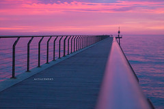 Pink. (arturii!) Tags: ocean trip morning travel bridge pink light sea sky people color beach beauty lines silhouette composition sunrise fence wow way coast early vanishingpoint amazing cool nice interesting dock holidays europe waves tour superb awesome horizon great shoreline catalonia minimal route deck direction stunning viatge catalunya simple vacations impressive mediterraneansea gettyimages badalona converging diminishingperspective pontdelpetroli arturii arturdebattk canonoes6d