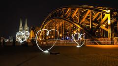 I love Cologne (Quitschiehund) Tags: lightpainting nacht kln nrw rhein nachtaufnahme em1 longtimeexposure hohenzollernbrcke zuiko1240