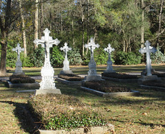 Graves in the cemeter of St. Joseph's Abbey, St. Benedict, Louisiana (Monceau) Tags: cemetery louisiana graves crucifix stbenedict gravemarker saintjosephabbey 105tombstonesgraveyard 116picturesin2016