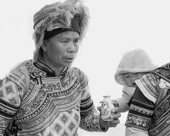 Hungry baby (tmeallen) Tags: china reaching drink grabbing ethnicminority yunnanprovince hungrybaby traditionalattire yuanyangcounty possiblymiao niujiaozhaimarket