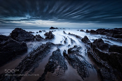 Barrika (Pity411) Tags: ocean travel blue sunset sea sky seascape black beach water stone clouds dark julien spain sand rocks long exposure mood darkness country playa bilbao bizkaia basque barrika delaval 500px ifttt