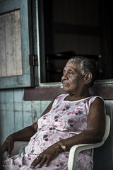 old lady portrait (Fredo de Luna) Tags: life street old travel family portrait people art love latinamerica beautiful beauty smile face rain vertical female real fun outdoors happy person photography one town eyes women friend costarica alone exterior village view adult gente head traditional country ngc culture lifestyle streetlife wear clothes kind identity event human experience portraiture wise editorial dailylife tradition iconic beautifuleyes manzanillo oneperson frontview caribe travelphotography traditionalclothing realpeople humanface lookingatcamera onewoman colorpicture traditionallifestyle realperson lookingtothecamera natgeofacesoftheworld yahoo:yourpictures=closeup
