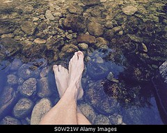 Uploaded to Stockimo (mlovette) Tags: park new travel cold feet creek river island stream stones south nelson zealand national pools hiker resting abel tasman tramp cleopatra sore sensory stockimo