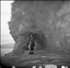 Do I know you? (Salt.as) Tags: camera sea portrait sky blackandwhite bw woman white black blur 120 6x6 film feet girl monochrome zeiss standing vintage mediumformat germany lens person photography foot shoe grey mono shoes rocks legs kodak bokeh tl tmax scanner leg shift ground jena iso greece negative german carl figure scanned epson medium format 100 28 v600 asa pentacon unfocused six tilt focused rapid ilford blury nafplio 80mm pentaconsix tiltshift 2016 fixer ilfosol biometar freelens freelensing