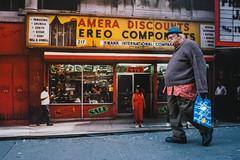 42nd Street (Jonathan Higbee) Tags: nyc newyorkcity urban newyork streets candid sony perspective streetphotography billboard midtown advertisements forcedperspective decisivemoment streetshot streetsincolor streettogs