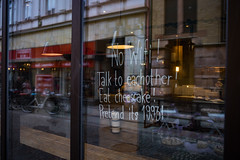 Cafe in Lund (Ruben Schneider) Tags: lund window caf 35mm reflections cafe sweden sony cheesecake 1993 wifi sverige a7