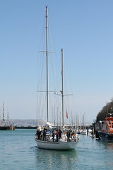 Training Day (rufftytufty) Tags: travel sky people tourism sport training landscape sailing risk harbour skills cliffs safety lifeboat ripples hull masts weymouth enjoyment teamwork