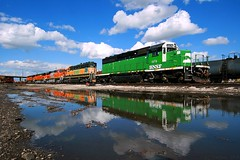 Cascade Reflections (Jeff Carlson_82) Tags: railroad reflection clouds train puddle ks wide railway bn kansas cs topeka railfan bnsf whiteface 1870 burlingtonnorthern emd sd402 burlingtonnorthernsantafe coloradosouthern cascadegreen topekashops