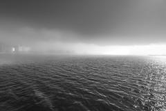 Vritnt sumuu (miikajom) Tags: sea blackandwhite sun mist fog suomi finland spring helsinki wide ruoholahti meri lauttasaari aurinko sumu silta kevt musta laru valkoinen laaja