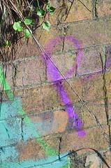 Purple P (Occasionally Focused) Tags: brick wall graffiti purple pentax takumar manualfocus sunny16 manuallens manualexposure unmetered rawtherapee justpentax takumarbayonet notevenchimped takumarbayonet135mm125