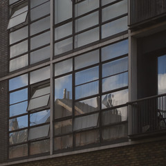 balcony and windows (Cosimo Matteini) Tags: reflection building london architecture pen olympus m43 mft ep5 cosimomatteini mzuiko45mmf18 balconyandwindows