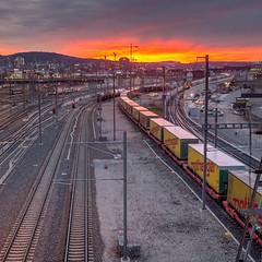 Sky on fire with some trains (jaeschol) Tags: switzerland railway sbb fujifilm zrich sbahn freighttrain kreis5 hardbruecke nothegger x100s