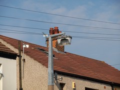 Vandalised Lamppost (doojohn701) Tags: uk roof sky house concrete lamppost cables vandalism damage sodium aei