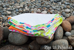 Neon quilt folded (pigsinpajamas) Tags: neon quilt fabric batting layercake basting backing jellyroll rileyblake