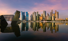 Sunrise on Marina Bay (.Randy.) Tags: city panorama reflection water sunrise singapore cityscape waterfront symmetry marinabay