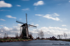 Windy at the windmill (Stephan Neven) Tags: cloud storm water netherlands windmill dutch canon landscape photo movement exposure le polder