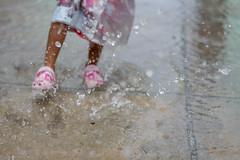 Fun in the Rain (meykaabe) Tags: rain fun puddle childern