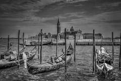 Gondolas (MacBeales) Tags: travel venice italy white black church canon boats island eos 350d europe lagoon spire gondolas